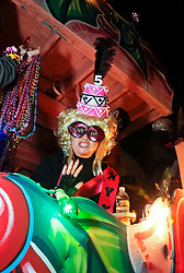 03 February 2016. New Orleans, Louisiana.<br /> Mardi Gras. The rider with the all female Mystic Krewe of Nyx as the Krewe parades along Magazine Street with brightly decorated floats, marching bands and dance troupes.<br /> Photo©; Charlie Varley/varleypix.com