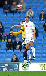 Oxford United's Tareiq Holmes-Dennis and Tranmere Rovers' Danny Holmes compete for the high ball - Photo mandatory by-line: Paul Knight/JMP - Mobile: 07966 386802 - 06/12/2014 - SPORT - Football - Oxford - Kassam Stadium - Oxford United v Tranmere Rovers - FA Cup Second Round