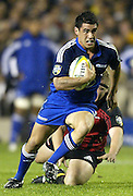 24 May 2003, Eden Park Auckland, Rugby Union, Xtra Super 12 Final, Auckland Blues vs Canterbury Crusaders.<br />Blue's David Gibson gets tackled by Crusader's Greg Somerville during the Blue's  21-17  win over the Crusaders on Saturday night.<br />Pic: Marty Melville/Photosport