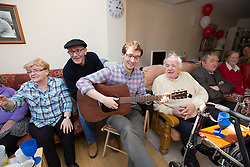 Marie O'Flaherty, Sean Wolohan and Reg Lacey sing along with Ronan Mahon of Novartis as the Novartis volunteers show off their hidden talents and entertain ALONE residents with music, jigs and reels at ALONE's Willie Bermingham premises in Dublin as part of the company's global Community Partnership Day. The initiative encourages staff to lend their time and support to local community organisations in need of volunteers, such as ALONE. ALONE is an independent charity that provides vital support to the one in 10 older people who are in need. Picture Andres Poveda