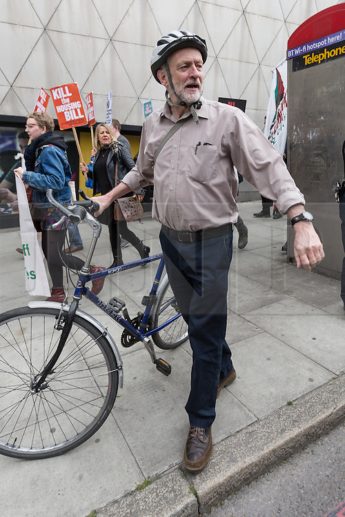 © Licensed to London News Pictures. 14/05/2016. LONDON, UK. JEREMY CORBYN with his bicycle, leaving a protest and march along Holloway Road, ending outside Holloway prison to protest against the housing bill and closure of Holloway prison. Protesters accuse the government of selling off the publicly owned inner city prison to private property developers, accelerating gentrification and worsening the UK's housing crisis. MP for Islington North, Jeremy Corbyn joined protesters and spoke of his support at the start of the demonstration.  Photo credit: Vickie Flores/LNP