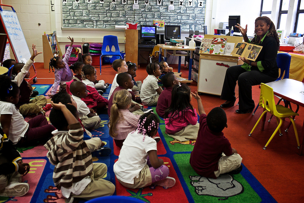 "Pre-kindergarten students at Calvin Rodwell Elementary School No. 256 in Baltimore, MD, ask questions to their teacher Erika Parker, right, as they read the book ""A Day at the Pumpkin Patch,"" a non-fiction children's book about visiting a farm. The book was part of a ""Common Core"" reading and learning unit, which aims to follow up non-fiction reading with learning in the field. The day after the children read the book about the farm, they visited Summers Farm in Frederick, MD."