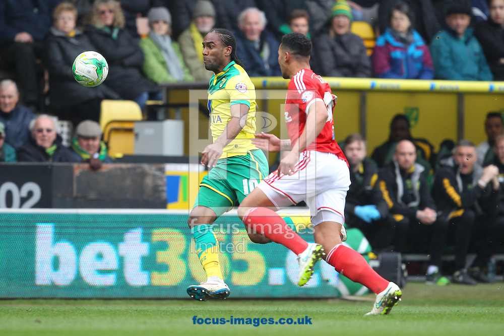 Cameron Jerome of Norwich and Jamaal Lascelles of Nottingham Forest in action during the Sky Bet Championship match at Carrow Road, Norwich<br /> Picture by Paul Chesterton/Focus Images Ltd +44 7904 640267<br /> 21/03/2015