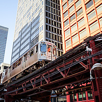 Chicago elevated L train with downtown Chicago buildings.
