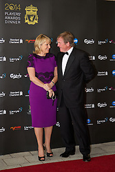 LIVERPOOL, ENGLAND - Tuesday, May 6, 2014: Liverpool FC non-executive director Kenny Dalglish and his wife Marina arrive on the red carpet for the Liverpool FC Players' Awards Dinner 2014 at the Liverpool Arena. (Pic by David Rawcliffe/Propaganda)