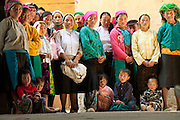 Many tribe people in Ha Giang watch a traditional dance in Dong Van old market in the sunny day. Their eyes are so special, some are intently, some are dreaming, some are so excited and listen to the rythm.