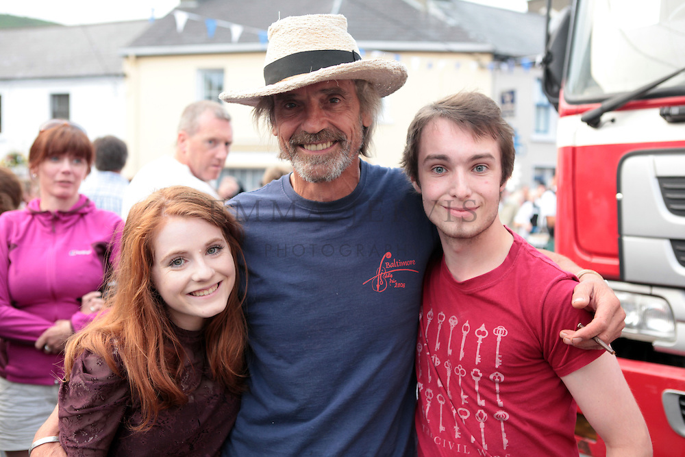 22/07/2013<br /> Actor Jeremy Irons officially opened the Union Hall Festival by The Sea on Sunday 21st July at the main square in Union Hall which was preceded by a colourful and fun fancy dress parade led by The Millstreet Pipe Band, St. Fachna's Silver Band, a parade of vintage cars and tractors and the local industrial parade. <br /> Pictured with actor Jeremy Irons were Leah Donnnelly (18 yrs) &amp; Colm O'Halloran (19 yrs)<br /> Picture: Emma Jervis