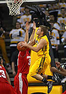 January 27, 2010: Iowa guard Cully Payne (3) drives to the basket during the first half of their game at Carver-Hawkeye Arena in Iowa City, Iowa on January 27, 2010. Ohio State defeated Iowa 65-57.