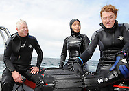 SIMONSTOWN, SOUTH AFRICA - Monday 9 September 2013 , Alan Winde MEC for Finance, Economic Development and Tourism in the Western Cape (left) with Nadia Salie and Judy Lain (Chief Marketing Officer for Wesgro), went scuba diving for cow sharks in False Bay. September is Tourism Month, an annual campaign driven by the National Department of Tourism in partnership with provincial Tourism bodies, and the Cape Town and the Western Cape theme is &lsquo;Water Connects Us&rsquo;. One of the most primitive shark species in the world, cow sharks are one of only two species that have seven gills and range in size from about 1.4 to 3.5 meters. This scuba experience took place in the kelp forests off the shoreline of Simonstown, where we went in search of our colony of cow sharks.  They are social feeders and group together which makes for an exciting experience.<br /> Photo by Roger Sedres/Image SA