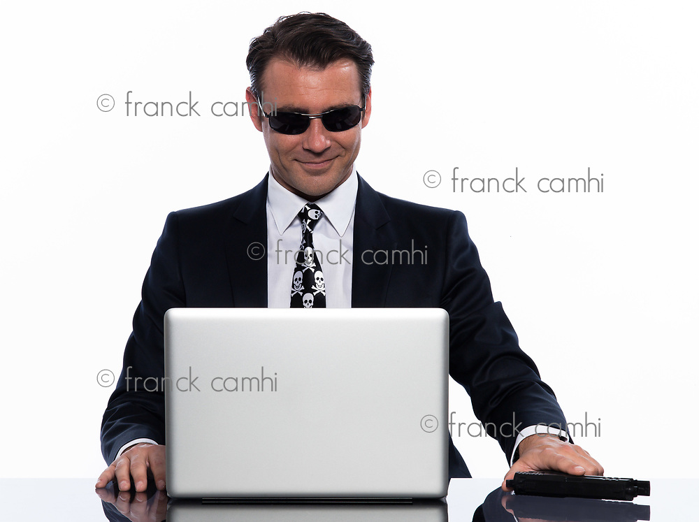 one man criminal hacker caucasian computer hacking computer laptop isolated studio on white background