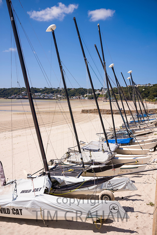Row of catamarans on St Aubin's sandy beach, Jersey, Channel Isles