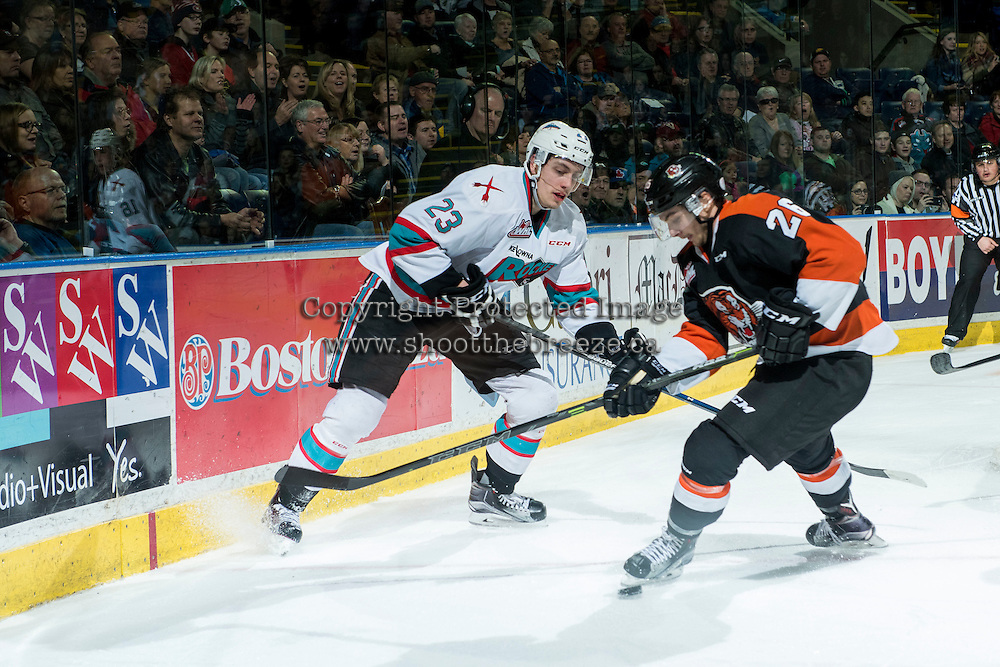 KELOWNA, CANADA - JANUARY 23: Brian Williams #26 of Medicine Hat Tigers checks Justin Kirkland #23 of Kelowna Rockets on January 23, 2016 at Prospera Place in Kelowna, British Columbia, Canada.  (Photo by Marissa Baecker/Shoot the Breeze)  *** Local Caption *** Justin Kirkland; Brian Williams;