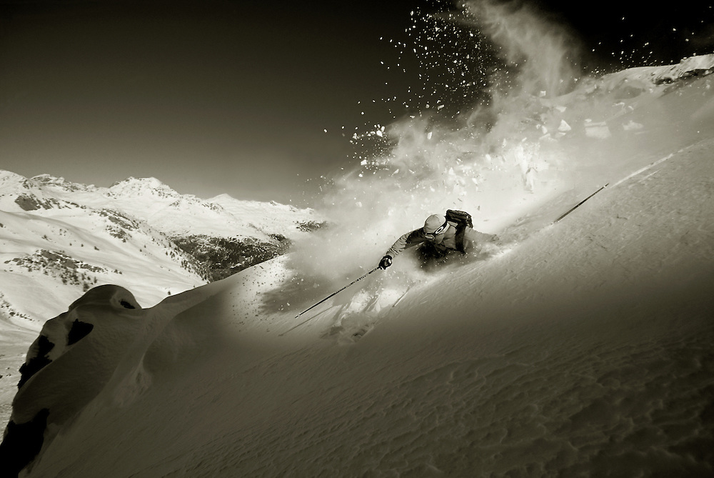 Skier turning in fresh powder snow on side of mountain Serre Chevalier France