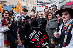 "© Licensed to London News Pictures. 23/11/2015. LONDON, UK. June Hudson (inventor of Doctor Who's iconic long scarf) stands with former Doctor Who girls, Katy Manning and Sophie Aldred as fans of Doctor Who known as ""Whovians"" and other supporters of the BBC gathered outside Broadcasting House in central London to oppose the threat of 20% government cuts to the Corporation. Photo credit : Stephen Chung/LNP"