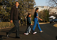 President Barack Obama, First Lady Michelle Obama and Sasha  Obama and a friend walk out of the White House to Marine One to travel to Camp David for the first time.   photo by Dennis Brack