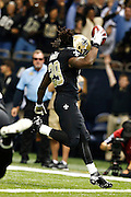 NEW ORLEANS, LA - NOVEMBER 11:  Chris Ivory #29 of the New Orleans Saints runs the ball for a touchdown against the Atlanta Falcons at Mercedes-Benz Superdome on November 11, 2012 in New Orleans, Louisiana.  The Saints defeated the Falcons 31-27.  (Photo by Wesley Hitt/Getty Images) *** Local Caption *** Chris Ivory
