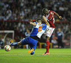 Bristol City's Marlon Harewood shoots outside the box under pressure from Bristol Rovers' Tom Parkes but fails to score.  - Photo mandatory by-line: Alex James/JMP - Tel: Mobile: 07966 386802 04/09/2013 - SPORT - FOOTBALL -  Ashton Gate - Bristol - Bristol City V Bristol Rovers - Johnstone Paint Trophy - First Round - Bristol Derby