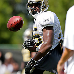 01 August 2009: New Orleans Saints running back Reggie Bush (25) tosses the ball back to a ball boy during New Orleans Saints training camp at the team's practice facility in Metairie, Louisiana.