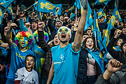 FC Astana fans sing during the club's Europa league game against Greek side Olympiacos, in the Astana Arena, in Astana, Kazakhstan. Astana FC is owned by the Kazakh state and was formed in 2009 to promote the city. Technically one of the richest teams in the world, in 2015 they became the first central Asian team to reach the Champions League group stage where they played against Atletico Madrid and Benfica, bringing international attention to the city.