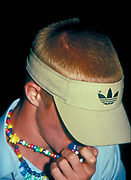 A man with an Adidas visor and a dummy in his mouth, UK, 2000's
