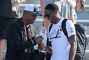 Jul 27, 2019; Des Moines, IA, USA; NFL former quarterback Randall Cunningham (left) visits with high jumper Erik Kynard during the USATF Championships at Drake Stadium.