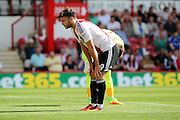 Brentford forward Scott Hogan (9)  with hands on knees during the EFL Sky Bet Championship match between Brentford and Ipswich Town at Griffin Park, London, England on 13 August 2016. Photo by Matthew Redman.
