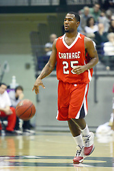 29 January 2011: Malcom Kelly during an NCAA basketball game between the Carthage Reds and the Illinois Wesleyan Titans at Shirk Center in Bloomington Illinois.