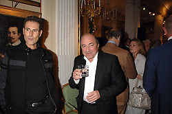 Left to right, URI GELLER and BORIS BEREZOVSKY at a reception to celebrate the launch of Prince Dimitri of Yugoslavia's one-of-a-kind jeweleery collection held at Partridge Fine Art, 144-146 New Bond Street, London on 11th June 2008.<br />