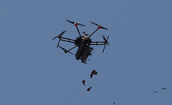 A drone used by Israeli troops fires teargas at Palestinians during a demonstrationat the border fence with Israel east of Khan Yunis in the southern Gaza Strip, Israeli soldiers killed at least 60 Palestinians and wounded more than 2,700. as demonstrations on the Gaza-Israel border coincided with the controversial opening of the U.S. Embassy in Jerusalem. This marks the deadliest day of violence in Gaza since 2014. Gaza's Hamas rulers have vowed that the marches will continue until the decade-old Israeli blockade of the territory is lifted. Gaza Strip, Palestine, May 15, 2018. Photo by Ashraf Amra/SalamPix/ABACAPRESS.COM