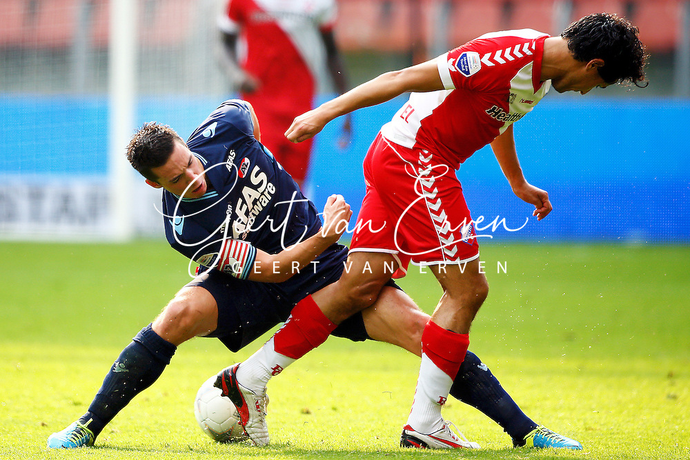 Onderwerp/Subject: FC Utrecht - AZ Alkmaar - Eredivisie<br /> Reklame:  <br /> Club/Team/Country: <br /> Seizoen/Season: 2013/2014<br /> FOTO/PHOTO: Mark VAN DER MAAREL (R) of FC Utrecht in duel with Nick VIERGEVER (L) of AZ Alkmaar. (Photo by PICS UNITED)<br /> <br /> Trefwoorden/Keywords: <br /> #04 $94 &plusmn;1371811811150<br /> Photo- &amp; Copyrights &copy; PICS UNITED <br /> P.O. Box 7164 - 5605 BE  EINDHOVEN (THE NETHERLANDS) <br /> Phone +31 (0)40 296 28 00 <br /> Fax +31 (0) 40 248 47 43 <br /> http://www.pics-united.com <br /> e-mail : sales@pics-united.com (If you would like to raise any issues regarding any aspects of products / service of PICS UNITED) or <br /> e-mail : sales@pics-united.com   <br /> <br /> ATTENTIE: <br /> Publicatie ook bij aanbieding door derden is slechts toegestaan na verkregen toestemming van Pics United. <br /> VOLLEDIGE NAAMSVERMELDING IS VERPLICHT! (&copy; PICS UNITED/Naam Fotograaf, zie veld 4 van de bestandsinfo 'credits') <br /> ATTENTION:  <br /> &copy; Pics United. Reproduction/publication of this photo by any parties is only permitted after authorisation is sought and obtained from  PICS UNITED- THE NETHERLANDS