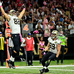 Oct 16, 2016; New Orleans, LA, USA; New Orleans Saints tight end Coby Fleener (82) celebrates after a touchdown catch during the first quarter of a game against the Carolina Panthers at the Mercedes-Benz Superdome. Mandatory Credit: Derick E. Hingle-USA TODAY Sports