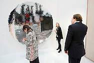 UK. London. The Frieze Art Fair in Reagent's Park..Photo shows people looking at an Anish Kapoor piece 'Untitled 2008'..Photo by Steve Forrest