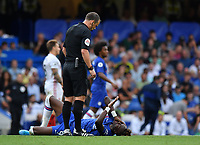 Football - 2019 / 2020 Premier League - Chelsea vs. Sheffield United<br /> <br /> Referee Stuart Attwelll checks on Chelsea's Tammy Abraham, at Stamford Bridge.<br /> <br /> COLORSPORT/ASHLEY WESTERN