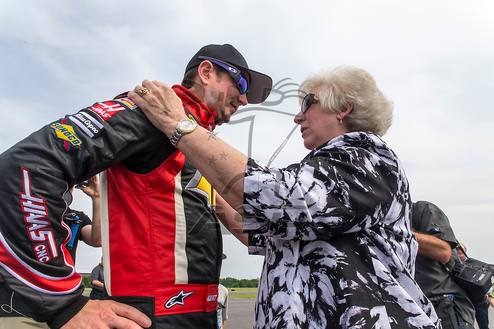 Concord, NC - May 25, 2014:  NASCAR driver, Kurt Busch (26), embraces his family after completing the Indianapolis 500 IndyCar race and landing at Concord Regional Airport in Concord, NC.<br /> <br /> MANDATORY PHOTO CREDIT:  Walter G. Arce, Sr. KBI/ActionSportsInc.com