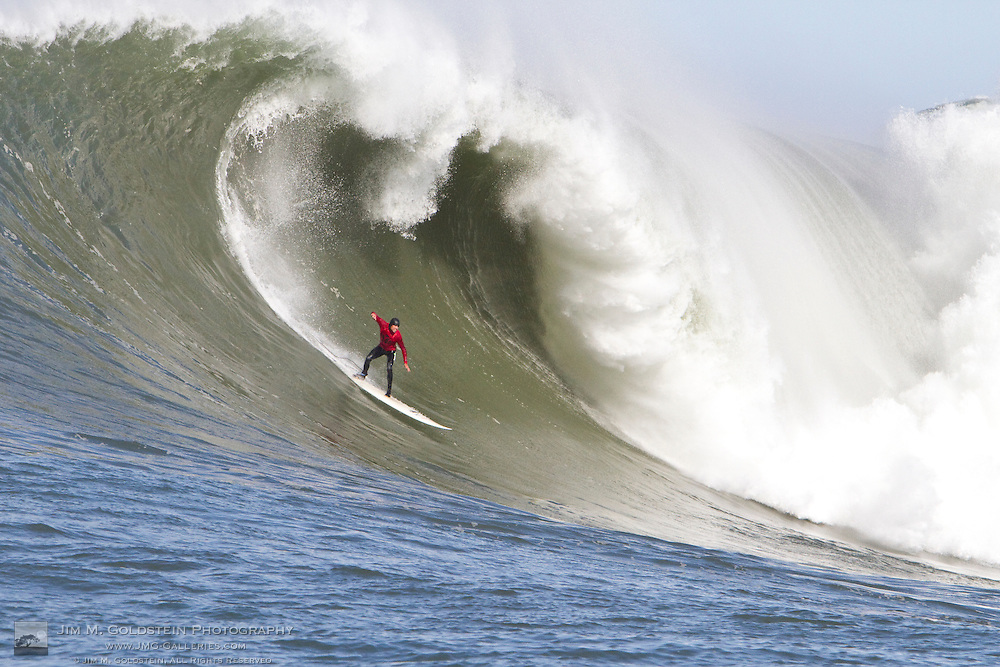 Alex Martins drops into a huge wave at the 2010 Mavericks Surf Contest - Half Moon Bay, California