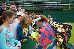 LONDON, ENGLAND - Monday, June 22, 2009: Michelle Larcher De Brito (POR) signs autographs for fans after her Ladies' Singles 1st Round victory on day one of the Wimbledon Lawn Tennis Championships at the All England Lawn Tennis and Croquet Club. (Pic by David Rawcliffe/Propaganda)