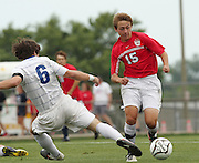 May 12, 2012; Huntsville, AL, USA;  Oak Mountain's Stephen Carroll (15) controls the ball against Auburn's Jack Goldberg (6).Mandatory Credit: Marvin Gentry