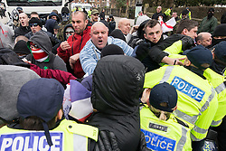 © Licensed to London News Pictures . 30/01/2016 . Dover , UK . Police separate the two groups . Demonstrations by far-right groups (including The National Front , The North West Infidels and The South East Alliance ) and , opposing them , anti-fascists , close to the port of Dover in Kent . Photo credit : Joel Goodman/LNP