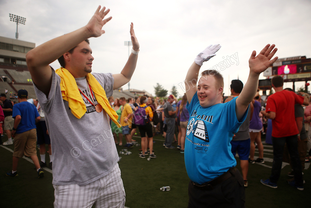 Special Olympians cheer and dance during the 2015 Michigan Summer Special Olympics photo by Claire Abendroth