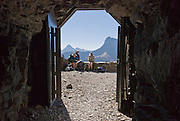 "In 1930, the Ptarmigan Tunnel was dug 183 feet through the Ptarmigan Wall for hikers from Many Glacier to reach the Belly River Valley in Glacier National Park, Montana, USA. Since 1932, Canada and USA have shared Waterton-Glacier International Peace Park, which UNESCO declared a World Heritage Site (1995) containing two Biosphere Reserves (1976). Rocks in the park are primarily sedimentary layers deposited in shallow seas over 1.6 billion to 800 million years ago. During the tectonic formation of the Rocky Mountains 170 million years ago, the Lewis Overthrust displaced these old rocks over newer Cretaceous age rocks. Glaciers carved spectacular U-shaped valleys and pyramidal peaks as recently as the Last Glacial Maximum (the last ""Ice Age"" 25,000 to 13,000 years ago). Of the 150 glaciers existing in the mid 1800s, only 25 active glaciers remain in the park as of 2010, and all may disappear by 2020, say climate scientists."