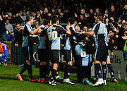 Wycombe  defender Jason McCarthy is mobbed by his teammates as he celebrates his goal to make it 2-1 during the Sky Bet League 2 match between Wycombe Wanderers and Oxford United at Adams Park, High Wycombe, England on 19 December 2015. Photo by David Charbit.
