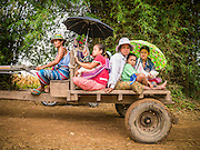 21 MAY 2013 - MAE KU, TAK, THAILAND:  Burmese patients from the Mawker Thai SMRU clinic in Mae Ku, Thailand take local transportation across the Moie River back to Burma. Health professionals are seeing increasing evidence of malaria resistant to artemisinin coming out of the jungles of Southeast Asia. Artemisinin has been the first choice for battling malaria in Southeast Asia for 20 years. In recent years though,  health care workers in Cambodia and Myanmar (Burma) are seeing signs that the malaria parasite is becoming resistant to artemisinin. Scientists who study malaria are concerned that history could repeat itself because chloroquine, an effective malaria treatment until the 1990s, first lost its effectiveness in Cambodia and Burma before spreading to Africa, which led to a spike in deaths there. Doctors at the Shaklo Malaria Research Unit (SMRU), which studies malaria along the Thai Burma border, are worried that artemisinin resistance is growing at a rapid pace. Dr. Aung Pyae Phyo, a Burmese physician at a SMRU clinic just a few meters from the Burmese border, said that in 2009, 90 percent of patients were cured with artemisinin, but in 2010, it dropped to about 70 percent and is now between 55 and 60 percent. He said the concern is that as it becomes more difficult to clear the parasite from a patient, progress that has been made in combating malaria will be lost and the disease could make a comeback in Southeast Asia.  PHOTO BY JACK KURTZ