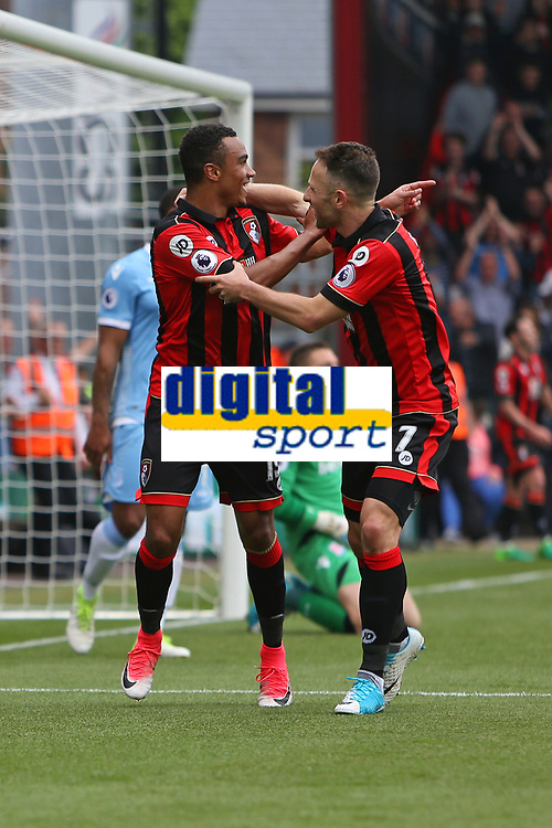 Football - 2016 / 2017 Premier League - AFC Bournemouth vs. Stoke City<br /> <br /> Bournemouth's Junior Stanislas celebrates scoring with Bournemouth's Marc Pugh at the Vitality Stadium (Dean Court) Bournemouth<br /> <br /> COLORSPORT/SHAUN BOGGUST