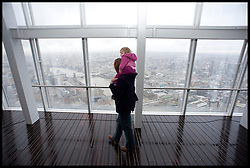 A father and daughter look at the view at out of the Shard as the London Mayor Boris Johnson officially opens the Shard building to the General public, central London, Friday February 1, 2013. Photo By Andrew Parsons / i-Images