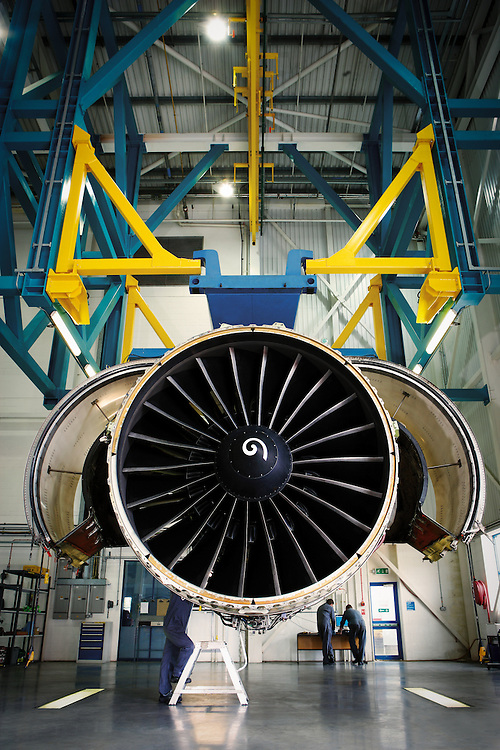 Servicing a General Electric jet engine at the facility in Cardiff, Wales.
