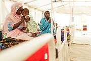 A woman interacts with her child, who is recovering from malnutrition, at a UNICEF-sponsored therapeutic feeding center at the Mongo hospital in the town of Mongo, Guera province, Chad on Tuesday October 16, 2012.
