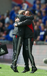 LONDON, ENGLAND - Saturday, April 14, 2012: Liverpool's manager Kenny Dalglish celebrates his side's 2-1 victory over Everton with assistant manager Steve Clarke during the FA Cup Semi-Final match at Wembley. (Pic by David Rawcliffe/Propaganda)