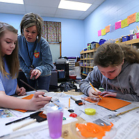 Adam Robison | BUY AT PHOTOS.DJOURNAL.COM<br /> Amy Dewett, fifth grade gifted teacher at Saltillo Elementary School, helps students Madison Dearing and Abby White with their Folk Art class project Tuesday morning in Saltillo.