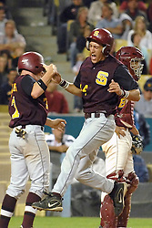Drew Sandler, left , and Chance Cross celebrate after scoring