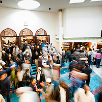 London, UK - 20 July 2012: London's Muslim faithful exit the East London Mosque during the first day of Ramadan.